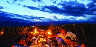 Opposite page: Dining al fresco at The Vines Resort & Spa in Chile.