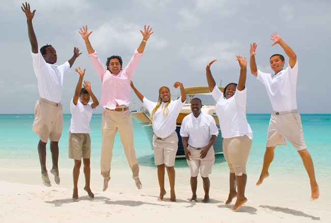 Nikheel with his staff at Grace Bay Resorts in Turks & Caicos.