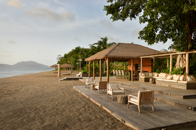 Guests can enjoy a mango-infused cocktail at Paradise Beach Nevis' Beach Bar.
