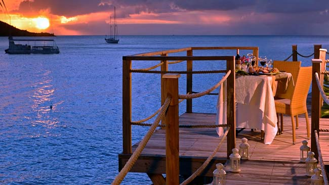 Guests can enjoy a romantic sunset meal at the Grand Case Beach Club in St. Martin.