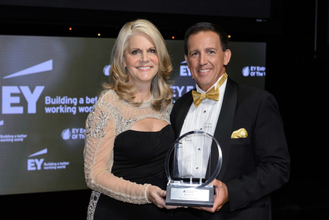 Michelle Fee, CEO of Cruise Planners, an American Express Travel Representative, being presented with the EY Entrepreneur Of The Year Award in Hospitality and Leisure.