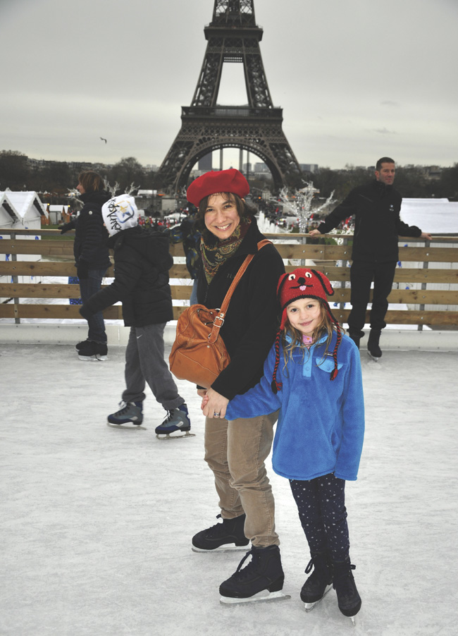 Jennifer with one of her children, ice skating in Paris.