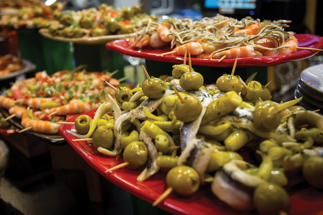 Silversea Cruises' menu of new culinary cruises allows passengers to immerse themselves in the foodie scenes in Europe and South. (Pictured: Pintxos (small snacks) at the Ribera Indoor Market in Bilbao, Spain.)