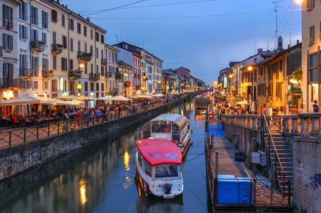 Evening scene along the Naviglio Grande canal in Milan with Discover Your Italy. (Discover Your Italy.)