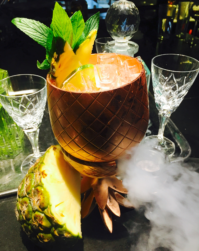Gilt Lounge at QT Sydney in Australia is serving up Aussie-inspired spins on classic cocktails such as The Gilligan (pictured)—a take on rum punch. (Photo credit: QT Hotels & Resorts)