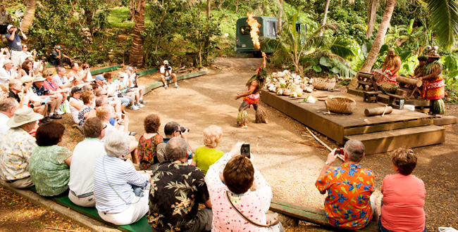 Chief Sielu and his Polynesian crew perform for YMT Vacations guests during one of the stops on our Circle Island Tour on Oahu.