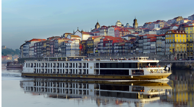 The Amavida cruising the Douro River in Porto, Portugal.