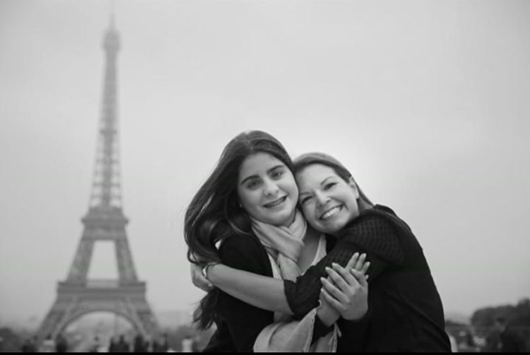 Diana and her baby cousin visiting Paris.