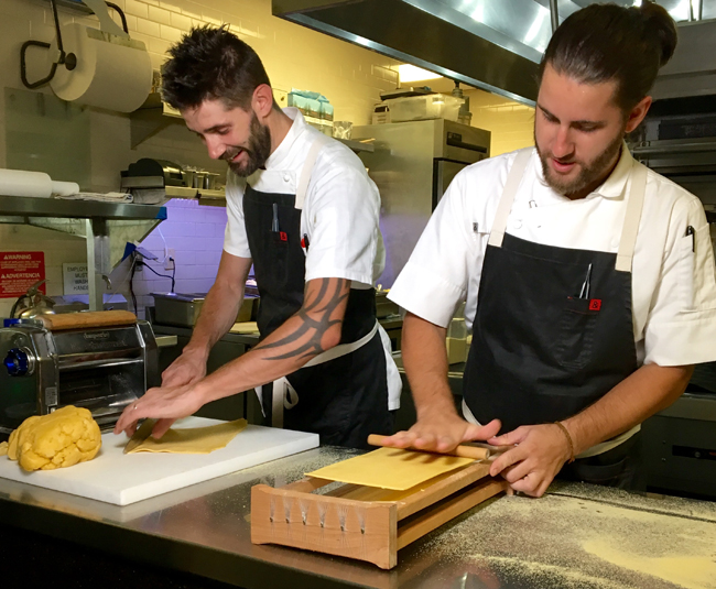 Chefs Jeff Maxfield and Andrea Marchesin in the Toscana Divino kitchen.