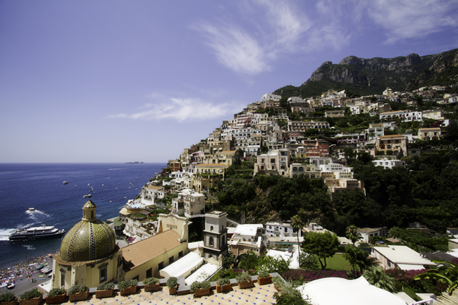 Azamara Club Cruises double upgrade deal allows guest to receive a complimentary double upgrade from a Club Interior to Club Veranda stateroom on select sailings. Amalfi, Italy (pictured).