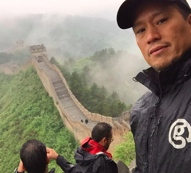 G Adventures founder Bruce Poon Tip at the Great Wall of China.