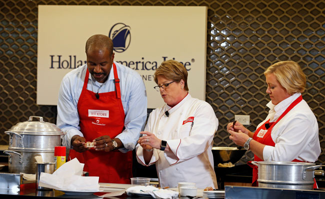 Holland America Line's president Orlando Ashford participating in a demo of the line's new onboard culinary program.