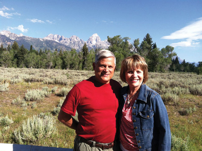 John and his wife touring the Grand Tetons. (Photo courtesy of Mayflower Tours.)