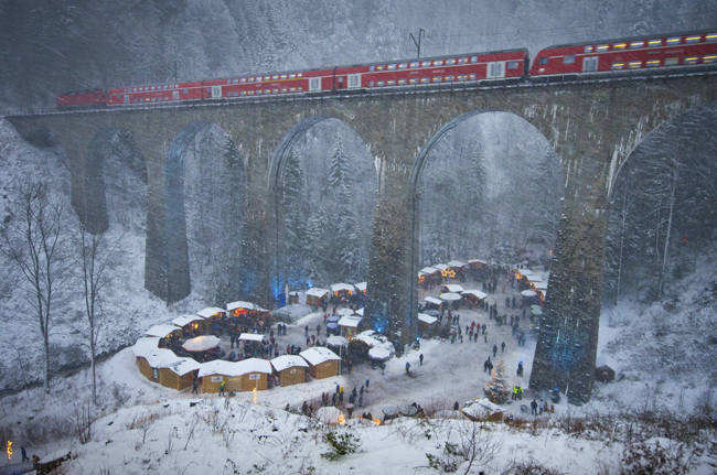 TheRavenna Gorge Christmas Market takes place in aGorge underneath arailway viaduct of the Devil's Valley Railway in the Black Forest Highlands.