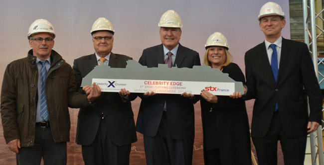 From left to right: Jean-Yves Jaouen, operations senior v.p., STX France; Harri Kulovaara, executive v.p. Newbuild and Innovation, Royal Caribbean Cruises, Ltd.; Richard D. Fain, chairman and CEO, Royal Caribbean Cruises, Ltd.; Lisa Lutoff-Perlo, president and CEO, Celebrity Cruises; and Laurent Castaing, general manager, STX France at the steel cutting for the new Celebrity Edge.