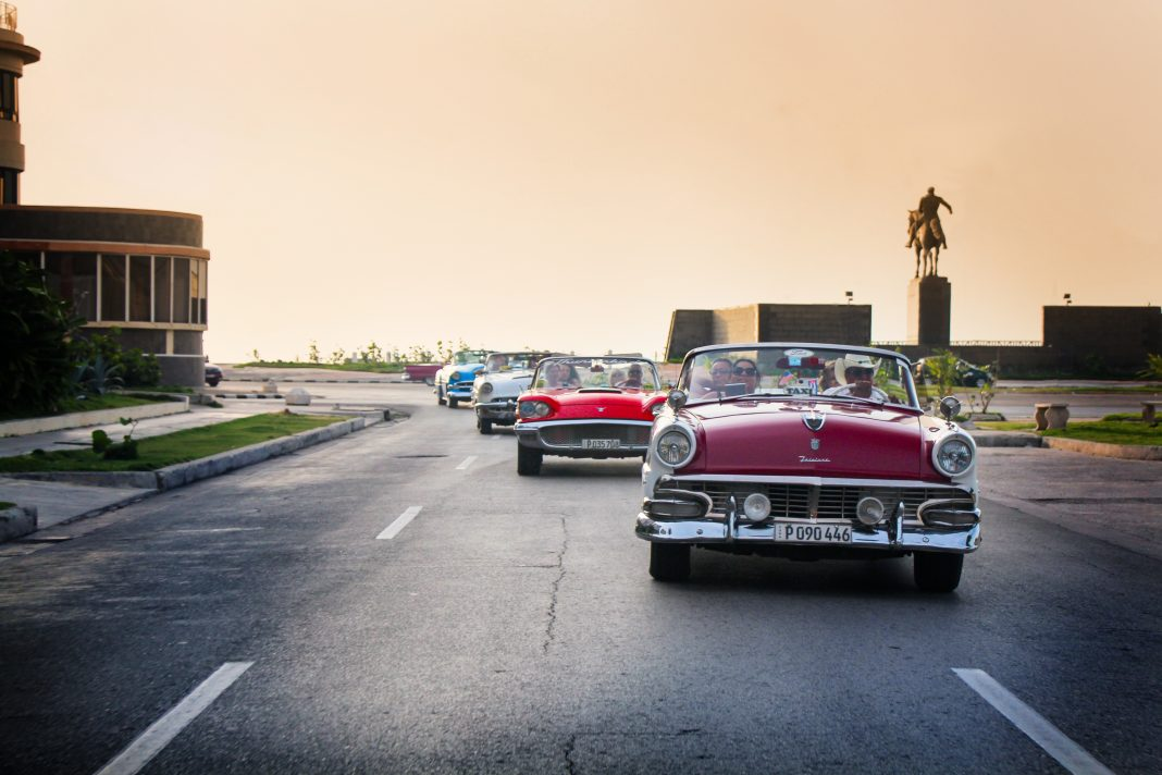 While in Cuba, travelers can ride around in vintage cars. (Photo courtesy of Travel Impressions.)