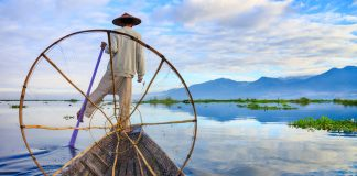 Fishermen in Myanmar's Inle Lake at sunrise.