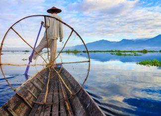 Fishermen in Myanmar's Inle Lake at sunrise.