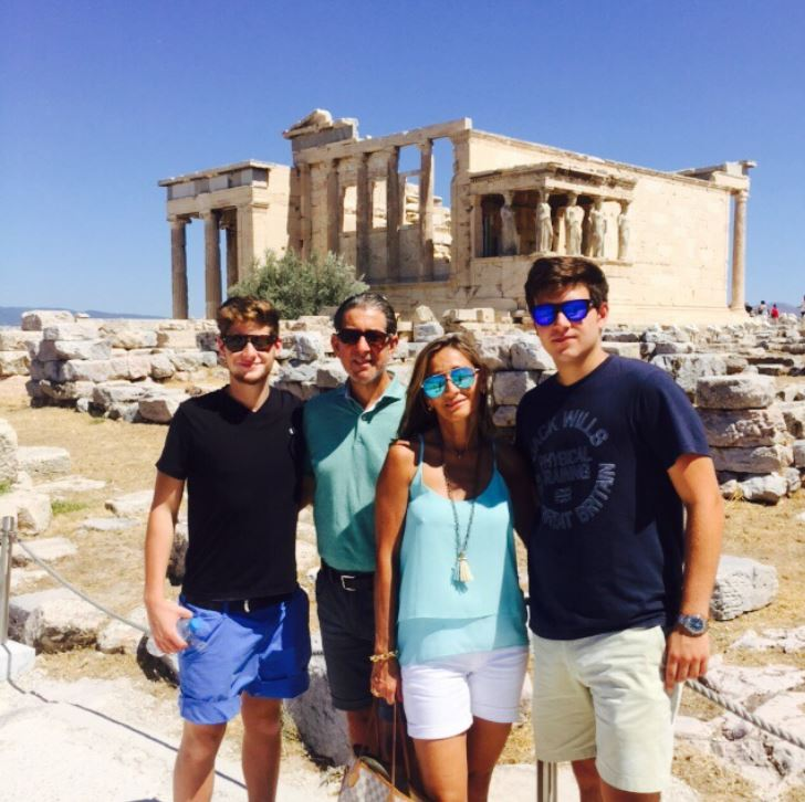 Andre traveling with his family in Greece.