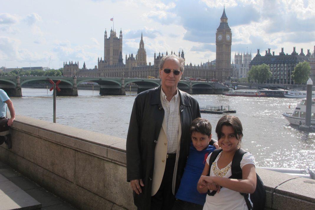 John in London with his grandchildren.