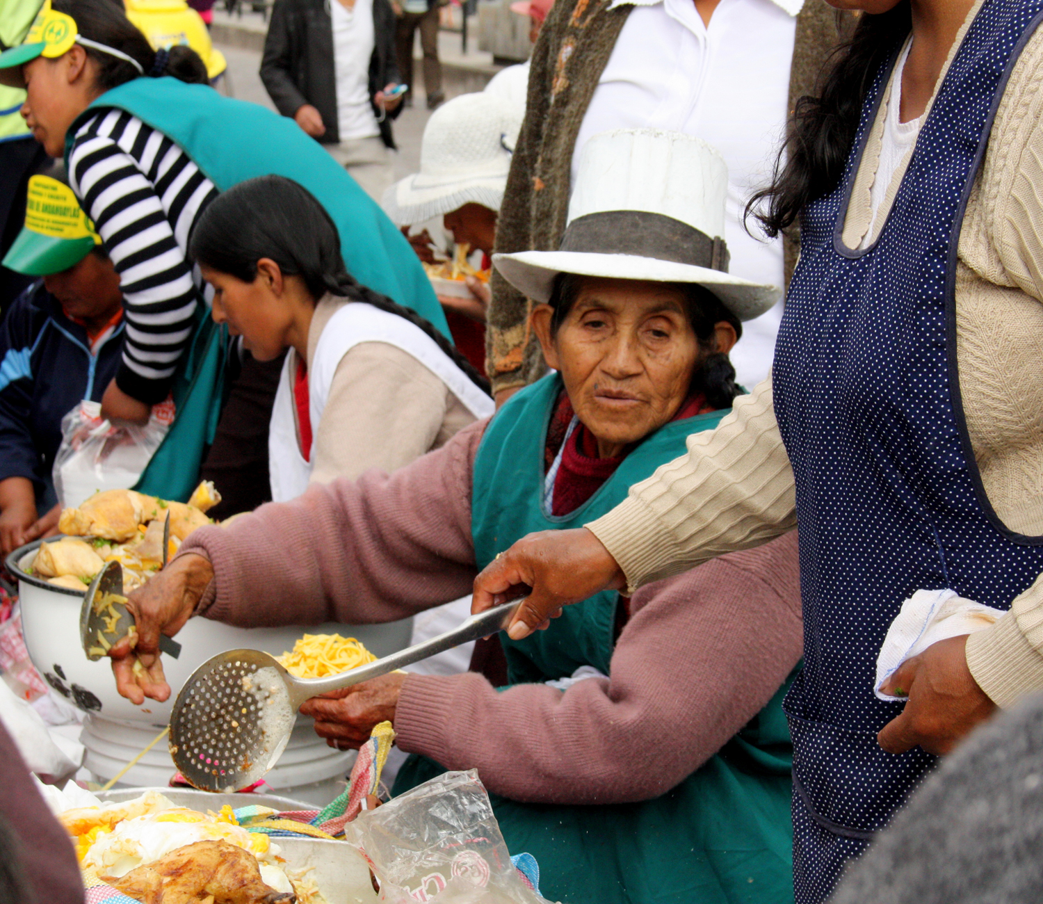 A woman serving food at the Inti Raymi Festival in Cusco.