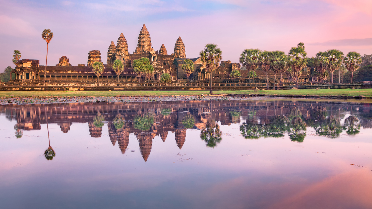 Angkor Wat temple at dramatic sunrise reflecting in water. (Insight Vacations)