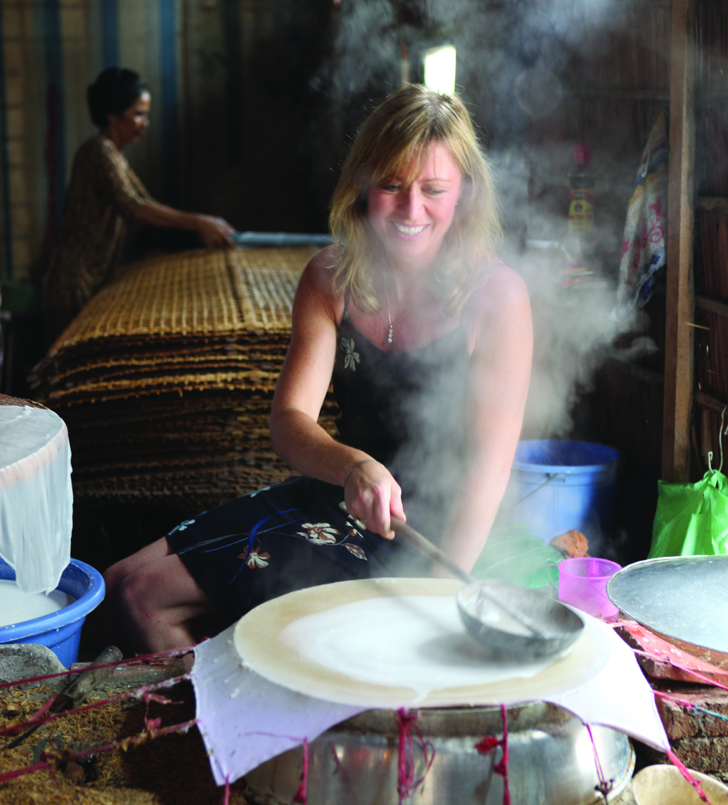 Kirstin making rice paper in Vietnam.