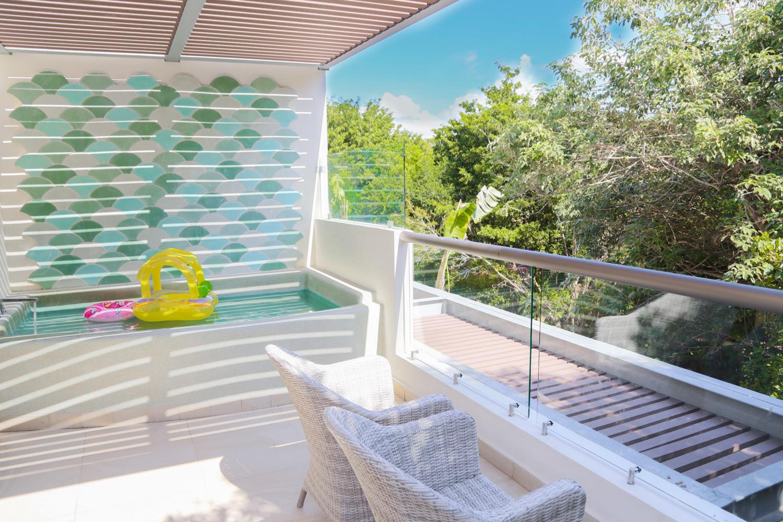 Signature Eco Junior Suite accommodations at Sandos Caracol Eco Resort in Riviera Maya.