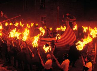 More than 800 Vikings join a massive dragon ship set ablaze by flying torches for Scotland's Up Helly Aa Festival in January. (Photo credit: Visit Scotland)