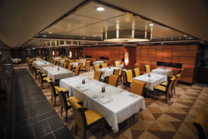 Norwegian Jade's popular Cagney's Steakhouse restaurant added additional seating to the completely refurbished space.