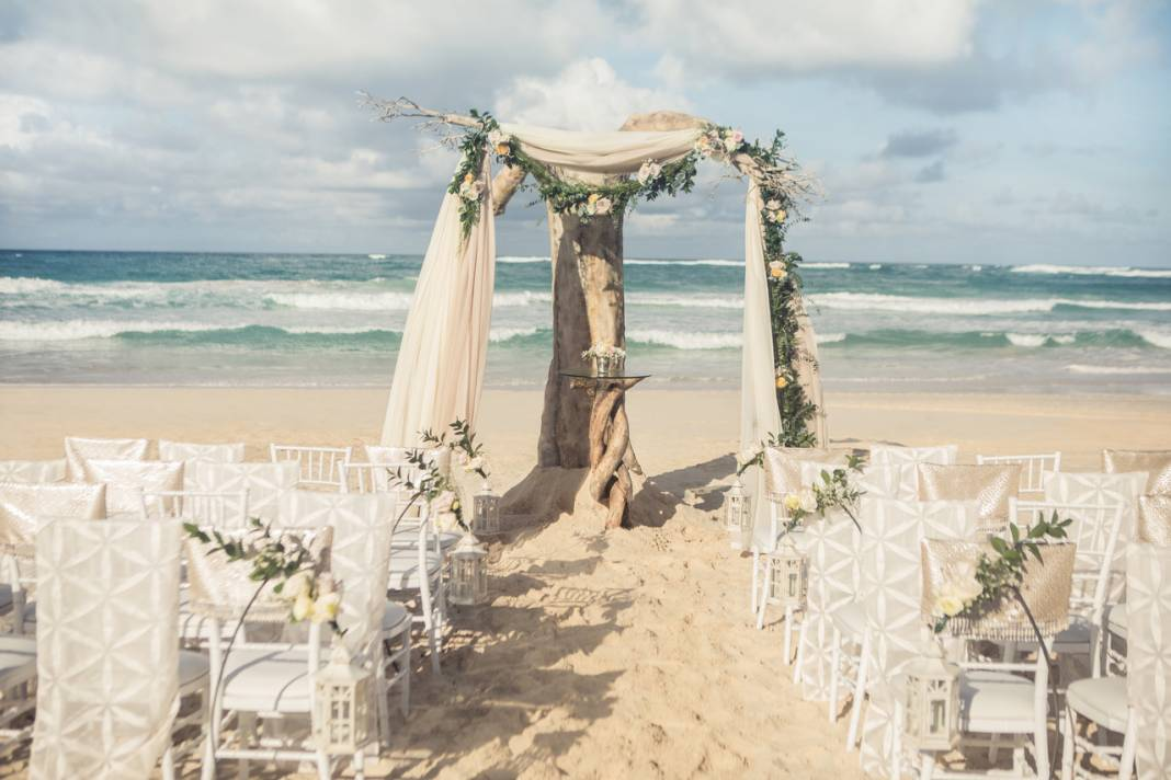 Colin Cowie Wedding Collections' Driftwood Romance ceremony features neutral earth tones and rich foliage.