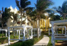 The path to the Ocean Front Suites at Iberostar Grand Hotel Paraiso is lined with palm trees and cozy cabanas.