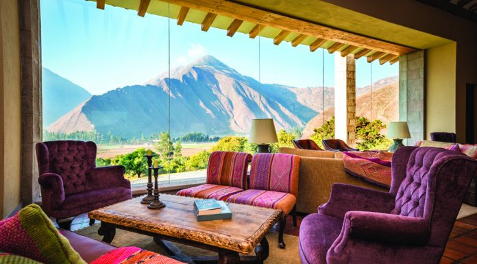A lobby with a view at Inkaterra Hacienda Urubamba in the Sacred Valley.