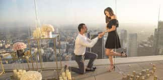 A proposal at OUE Skyspace LA overlooking the LA skyline. (Photo credit Szuszanik Hovakimyan.)