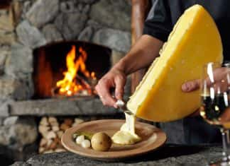 On Alpenwild'sCheese, Chocolate, and Wine in the Scenic Alpstour, guests have the option to make artisan alpine cheese.