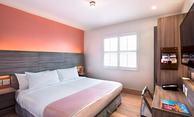 The Flagler King guestroom at The Julia. (Photo courtesy of The Julia.)