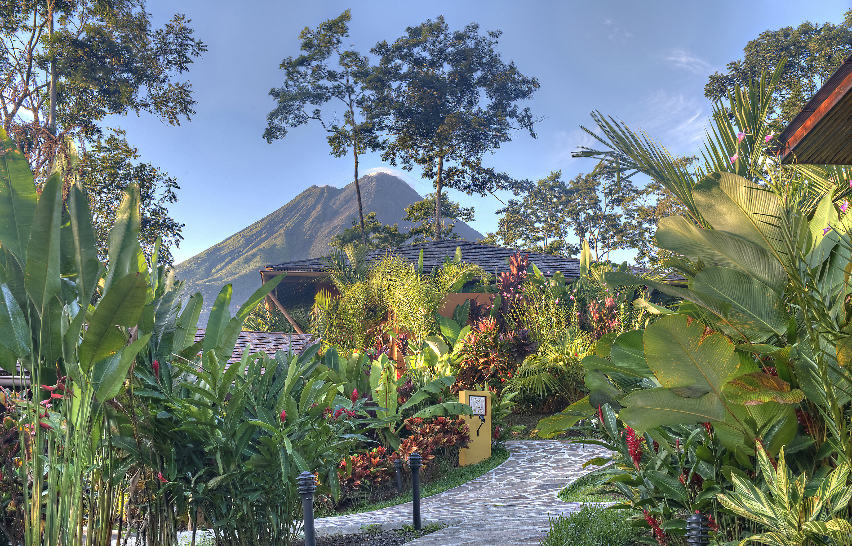 Costa Ricas Arenal Volcano Peeks Out Through The Trees At Nayara Springs