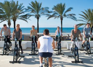 Outdoor spinning class is one of many activities guests can participate in to stay fit while on vacation at IBEROSTAR.