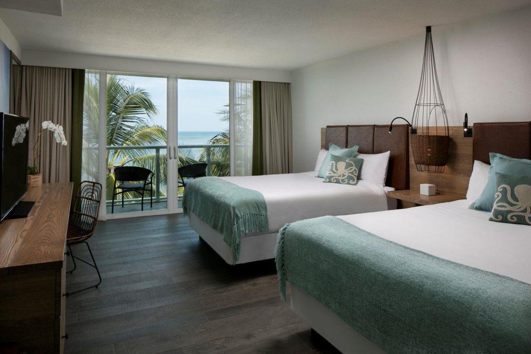 The Double Queen Ocean View Guestroom at Amara Cay Resort.