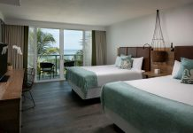 The Double Queen Ocean View Guestroom at Amara Cay Resort.