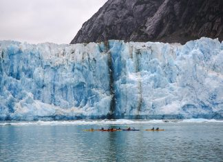 Guests on an UnCruise Adventures voyage in Alaska can explore the area on a kayak.