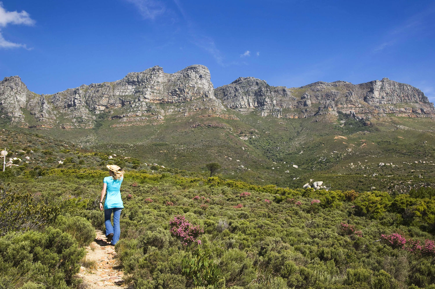 A traveler enjoying a mountain walk. (Photo courtesy of The Twelve Apostles.)