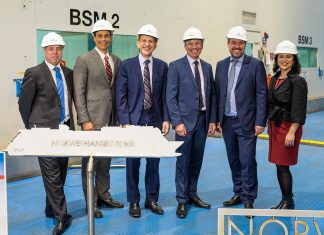 Executives from Norwegian Cruise Line Holdings and MEYER WERFT at the steel cutting for the cruise line's newest ship.