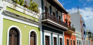 At the street level, the pastel-colored houses of Old San Juan seem unscathed by last year's Hurricane Maria. Photo Credit: Ed Wetschler