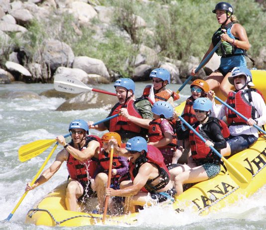 Taking on the rapids on the Yellowstone river. (Photo courtesy of Austin Adventures.)