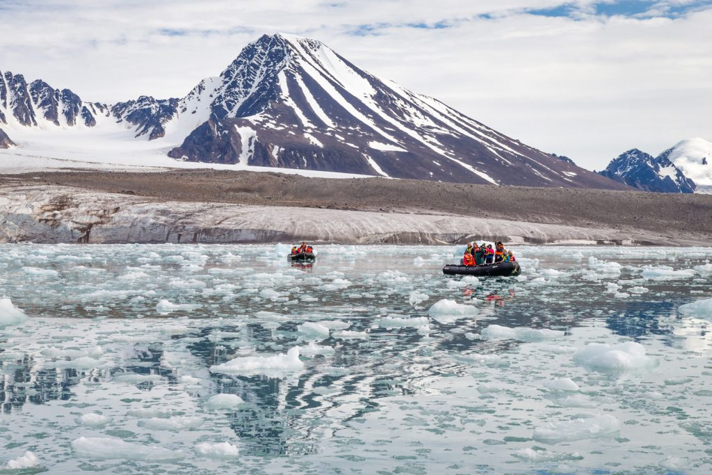 Guests take a zodiac expedition to explore on this Arctic Safari itinerary. (Photo credit: Joe Van Os, courtesy of TravelWild Expeditions.)