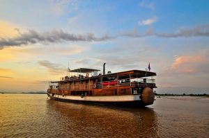 Guests enjoy a sail on the 10-cabin Mekong Riverboat. (Photo Courtesy of Grasshopper Adventures.)
