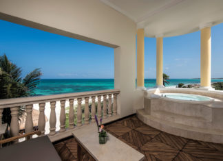 The oceanfront suite offers a spacious terrace with views of paradise.