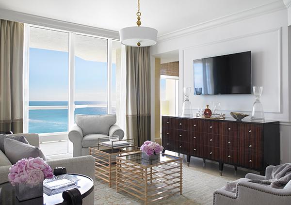 The living room inside a 2-bedroom Oceanfront Suite.