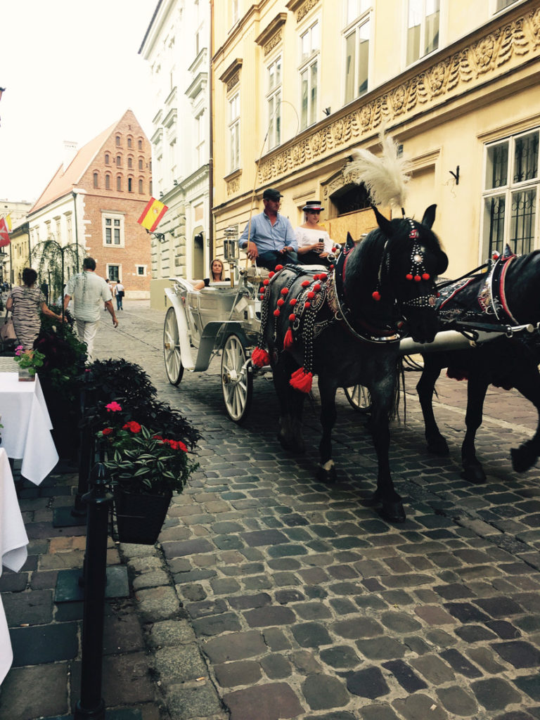 Krakow's Old Town can be enjoyed on a horse-drawn carriage ride. (Paloma Villaverdo de Rico)
